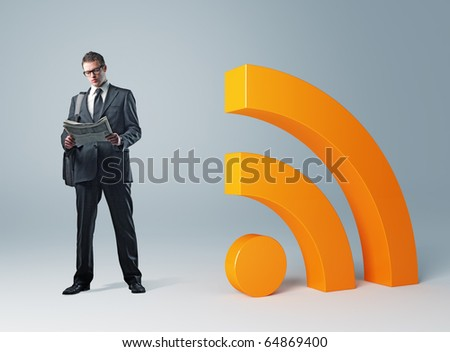 young businessman with newspaper and rss symbol - stock photo