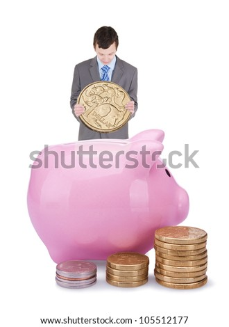 Young businessman with pigggy bank isolated on white background - stock photo