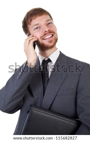 Young businessman with smart phone - stock photo