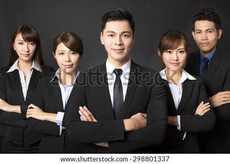 young businessman with successful business team  - stock photo