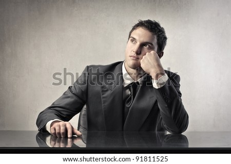 Young businessman with thoughtful expression - stock photo