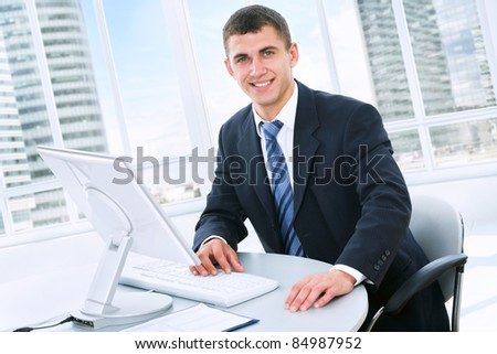 Young businessman working in office - stock photo