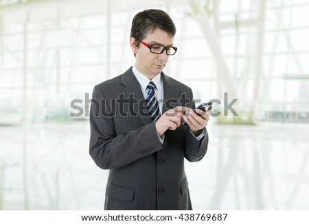 young businessman working on the phone, at the office - stock photo