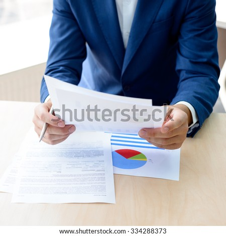 Young Businessman Working with Financial Documentation in the Modern Office. Business Concept - stock photo
