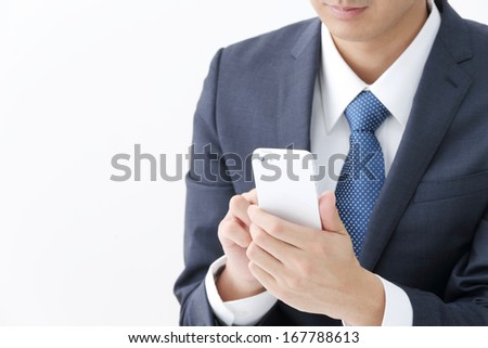 Young businessman working with modern devices - stock photo
