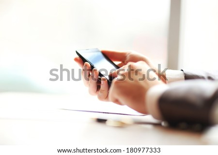 Young businessman working with modern devices, mobile phone. - stock photo