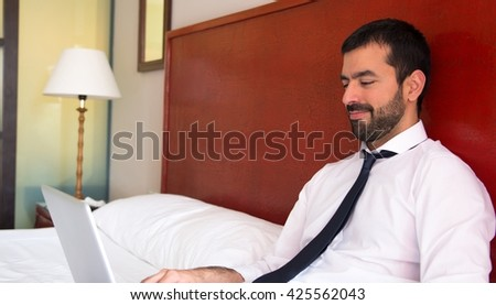 Young businessman worning in hotel - stock photo