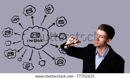 Young businessman writing e-mail schema on whiteboard - stock photo