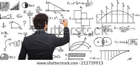 Young businessman writing math formulas - stock photo