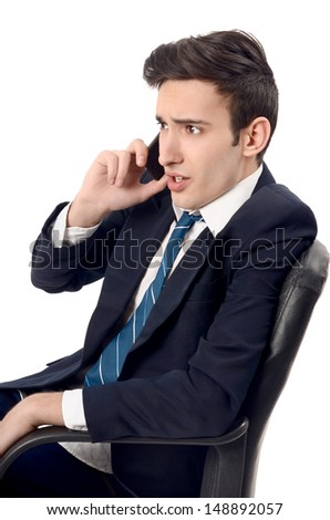 Young businessman yelling on the phone. Upsetting business phone conversation. Isolated on white background. - stock photo