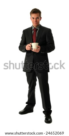 Young businessmen holding a cup of tea isolated on white - stock photo