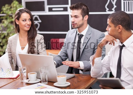 Young businessmen working in the caffe - stock photo