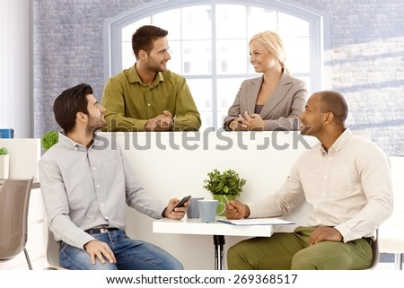 Young businesspeople brainstorming in office. - stock photo