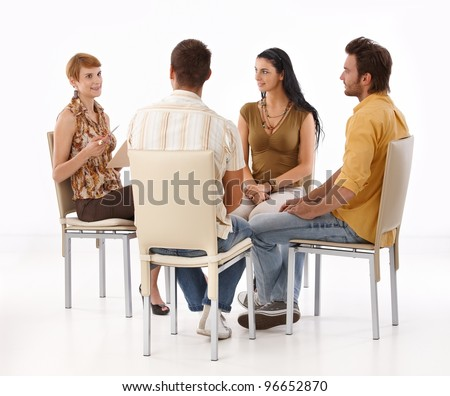 Young businesspeople brainstorming, sitting in circle.? - stock photo