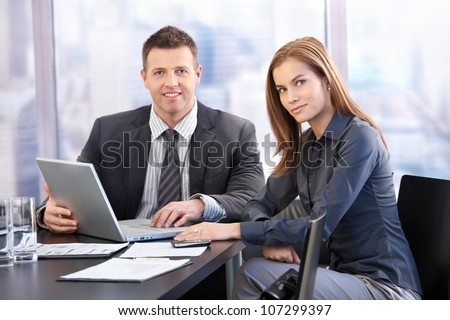 Young businesspeople having meeting in bright boardroom. - stock photo