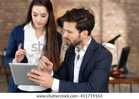 Young businesspeople using tablet computer. working. - stock photo