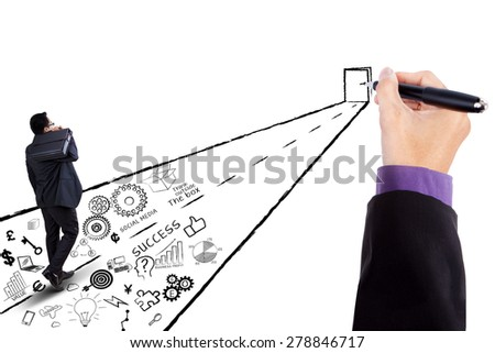 Young businessperson walking toward open door to get his target and success - stock photo