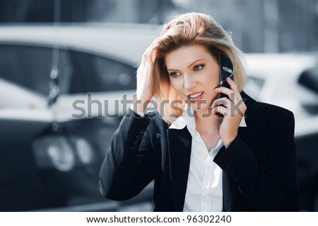 Young businesswoman calling on the phone - stock photo
