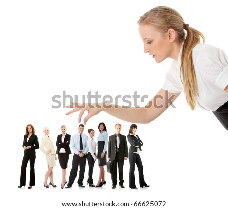 Young businesswoman choosing worker from group of businesspeople, isolated on white. - stock photo