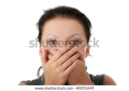 Young businesswoman covering her mouth with hands - stock photo