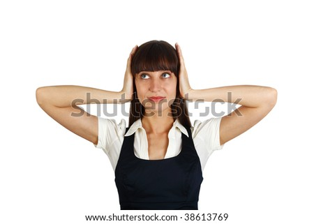 young businesswoman covers her ears with her hands looking worried - stock photo