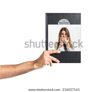 Young businesswoman doing surprise gesture printed on book - stock photo