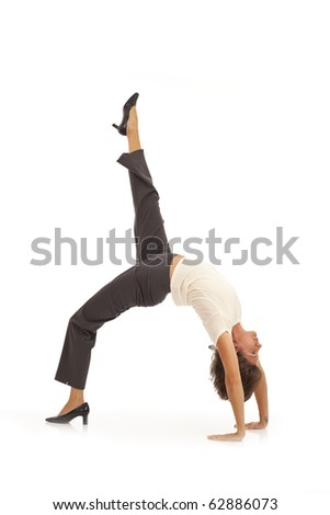 Young businesswoman doing yoga - stock photo
