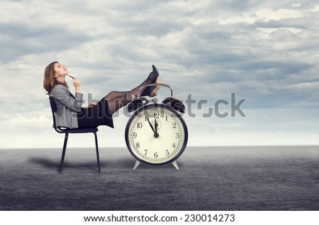 Young businesswoman dreaming sitting on a chair in the open air. - stock photo