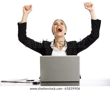 Young Businesswoman excited looking at laptop - stock photo