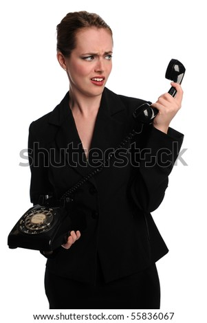 Young Businesswoman expressing surprise while using vintage phone - stock photo