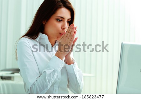 Young businesswoman feeling freezy in office - stock photo