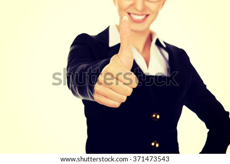 Young businesswoman gesturing thumbs up - stock photo