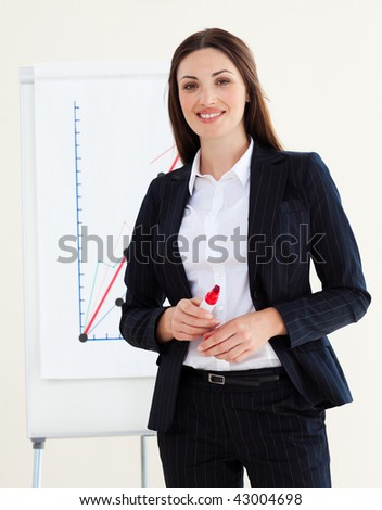 Young businesswoman giving a conference in the office - stock photo