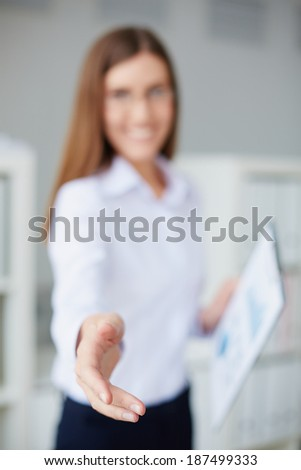 Young businesswoman hand welcoming you - stock photo