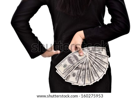 Young businesswoman hides a lot of dollars in hands, isolated on white background - stock photo