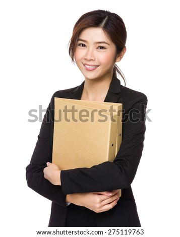 Young businesswoman hold with folder - stock photo