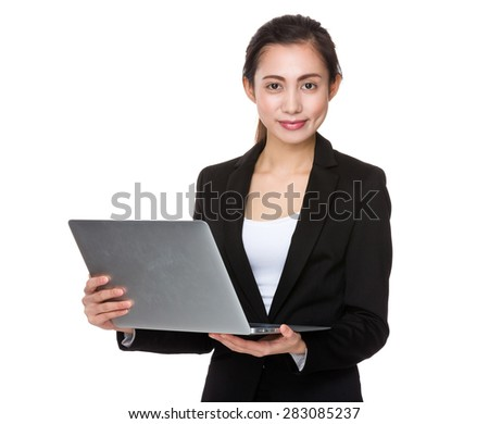 Young businesswoman hold with notebook computer - stock photo