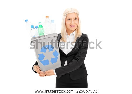 Young businesswoman holding a recycle bin isolated on white background - stock photo