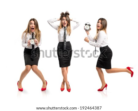 Young businesswoman holding an antique clock over white background  - stock photo