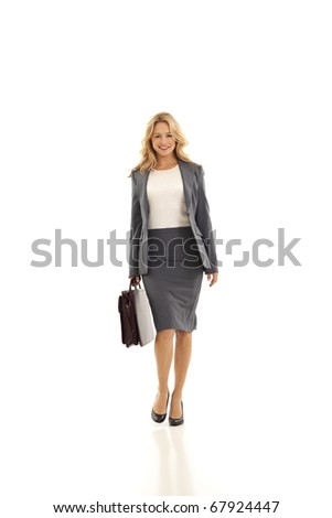 Young businesswoman holding briefcase - stock photo