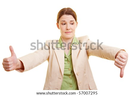 Young businesswoman holding her thumb up and down - stock photo