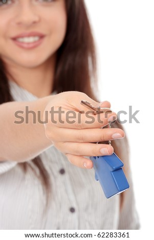 Young businesswoman holding house shaped key chain, isolated on white background - stock photo