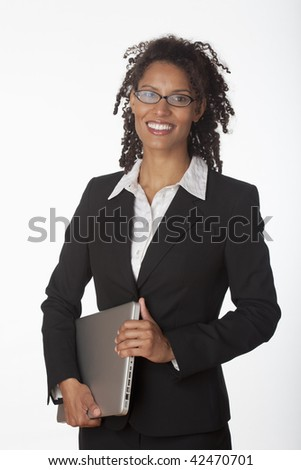 Young businesswoman holding laptop. Vertically framed shot. - stock photo