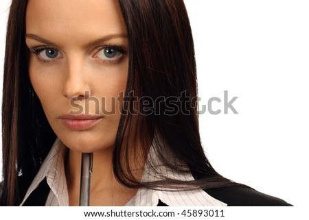 Young businesswoman holding pen - stock photo