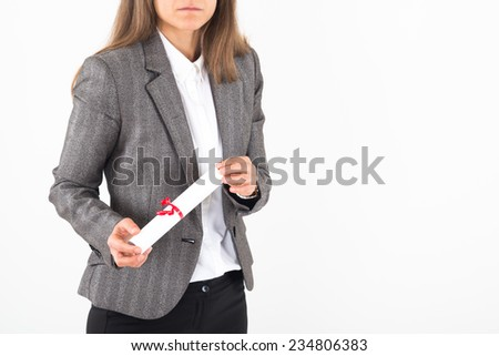 Young Businesswoman holds up her certificate - stock photo