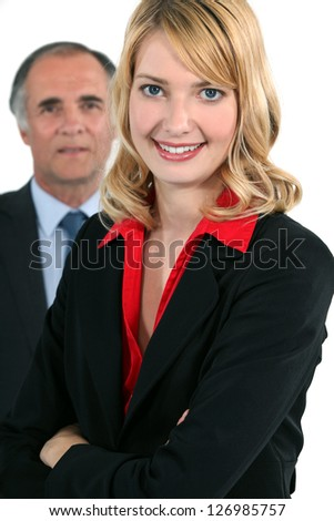 Young businesswoman in front of an older businessman - stock photo