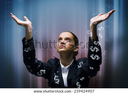 Young businesswoman in tears praying at dollar symbol - stock photo