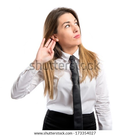 Young businesswoman listening over isolated white background  - stock photo