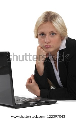 young businesswoman looking bored - stock photo