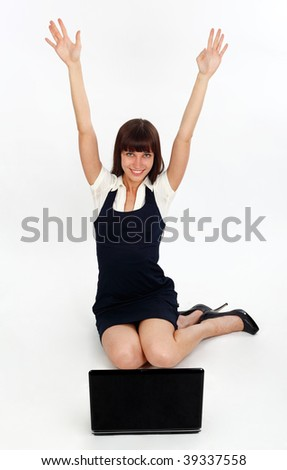 young businesswoman looking happy as she uses a laptop - stock photo